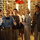 Director Val Waxman (WOODY ALLEN, left) is trying to describe what he envisions for the next scene to (left to right) his cinematographer's translator (BARNEY CHENG) and studio executives Ellie (TÉA LEONI) and Ed (GEORGE HAMILTON) in Woody Allen's latest contemporary comedy HOLLYWOOD ENDING, being distributed domestically by DreamWorks.