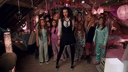 """St Trinian's, a school for """"young ladies"""" with its anarchic doctrine of free expression, brings together a motley crew of ungovernable girls who, using their wit and ingenuity, save the school from bankruptcy."""