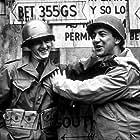"Bob Newhart and Bobby Darin filming ""Hell is for Heroes"" at Paramount Studios, 1961."