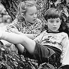 Thora Birch and Elijah Wood in Paradise (1991)