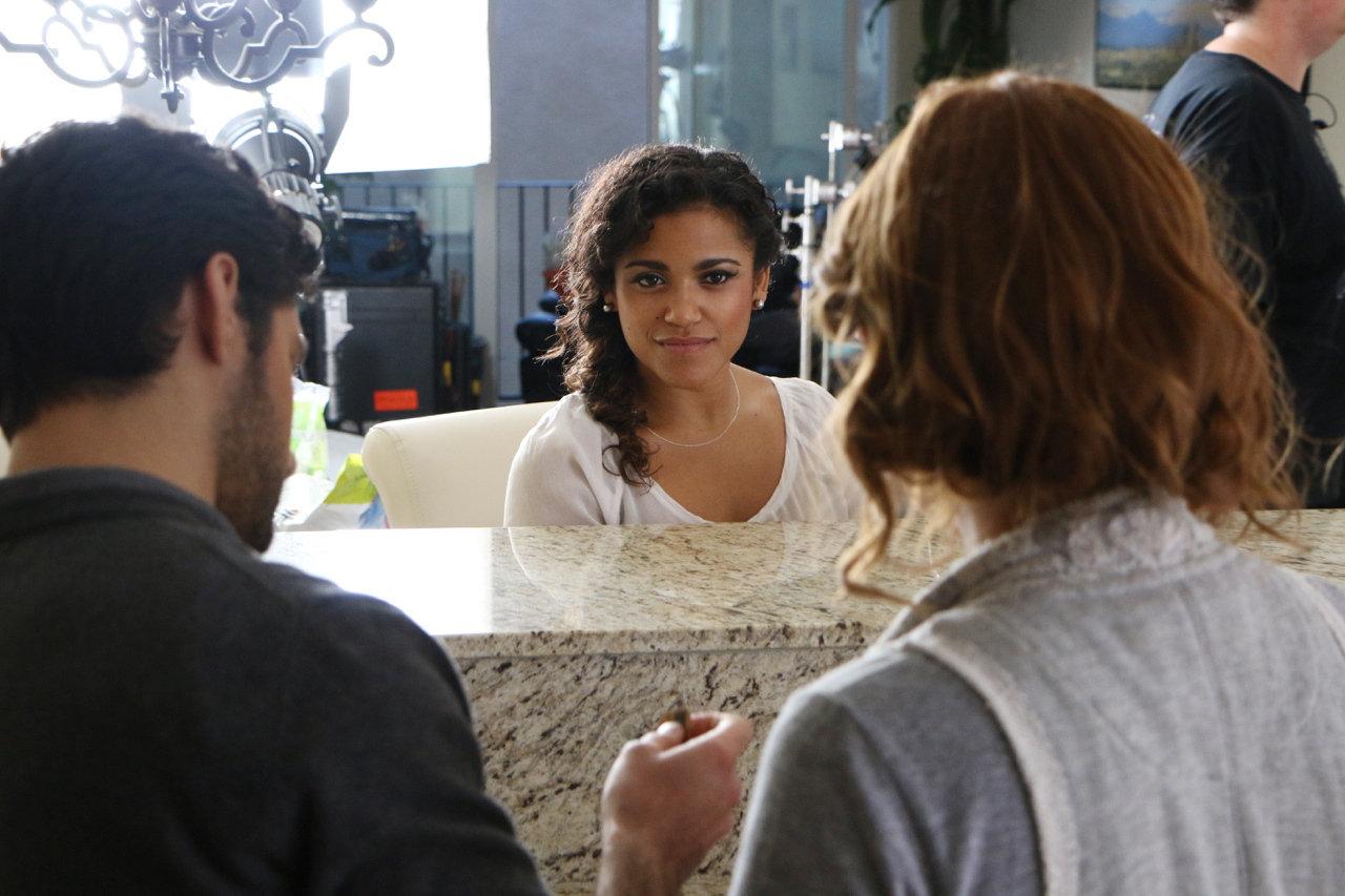 Director Sarah Phillips chats with actors Vivian Lamolli and Noah James.