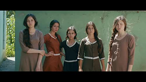 Early summer. In a village in northern Turkey, Lale and her four sisters are walking home from school, playing innocently with some boys. The immorality of their play sets off a scandal that has unexpected consequences. The family home is progressively transformed into a prison; instruction in homemaking replaces school and marriages start being arranged. The five sisters who share a common passion for freedom, find ways of getting around the constraints imposed on them.