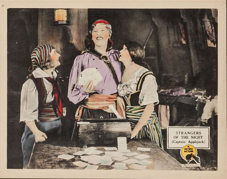Enid Bennett, Barbara La Marr, and Matt Moore in Strangers of the Night (1923)