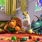 Tom Hanks, Timothy Dalton, Jeff Garlin, and Kristen Schaal in Toy Story 3 (2010)