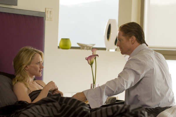 Eric Stoltz and Paula Malcomson in Caprica (2009)