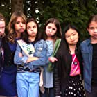 """The cast of """"Smart Cookies"""" (2012) in wardrobe. Left to right: Maddy Yanko, Jessalyn Gilsig, Bailee Madison, Michelle Creber, Melody B. Choi, Claire Margaret Corlett."""