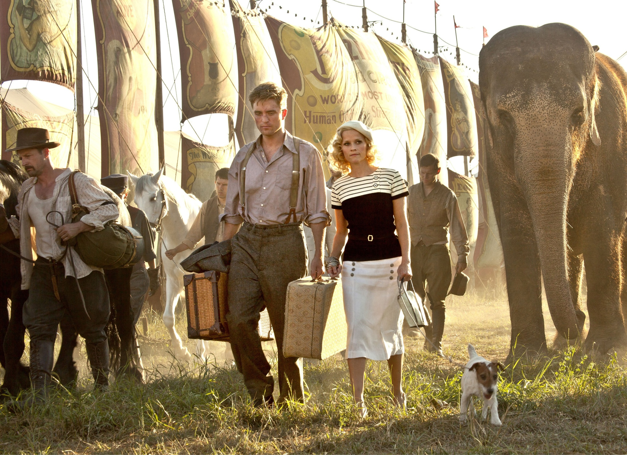 Reese Witherspoon, Tim Guinee, Robert Pattinson, Tai, and Uggie in Water for Elephants (2011)