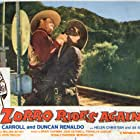 Richard Alexander and John Carroll in Zorro Rides Again (1937)