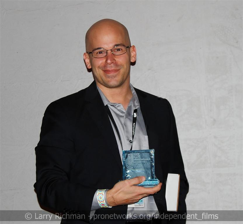 Brian Crewe accepts the award for Best American Short Film at the 2012 Fort Lauderdale Film Festival for his short film FAR
