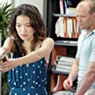 Jason Statham and Shu Qi in The Transporter (2002)