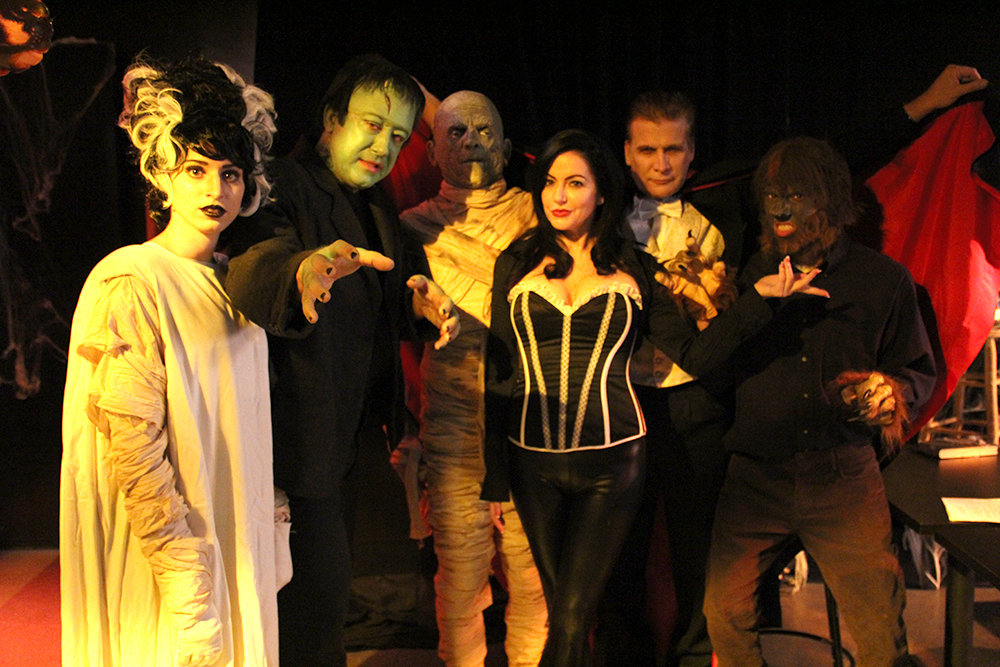 Talia Banuelos as The Bride, Perry Shields as Frankenstein's Monster, Alan August as The Mummy, Natalie Popovich as Ivonna Cadaver, Dean Scofield as Count Dracula, and Alexander Clague as The Wolf Man in MONSTER SCHOOL - A NEW SITCOM.