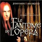 Asia Argento and Julian Sands in Il fantasma dell'opera (1998)