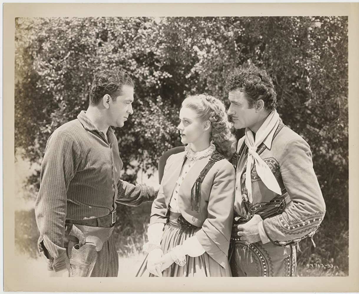 Angela Greene, Gilbert Roland, and Anthony Warde in King of the Bandits (1947)