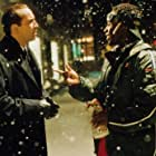 Nicolas Cage and Don Cheadle in The Family Man (2000)