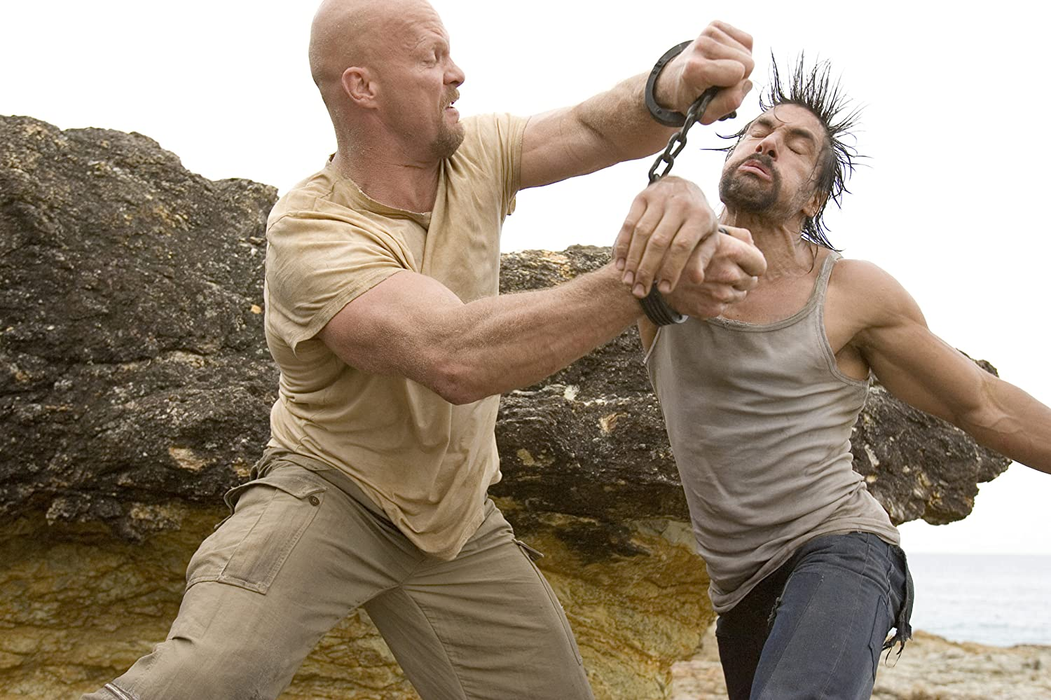 Steve Austin and Manu Bennett in The Condemned (2007)