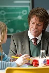 John Noble and Karley Scott Collins in Fringe (2008)