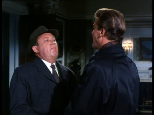 Roger Moore and Ivor Dean in The Saint (1962)