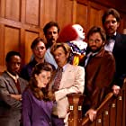 Tim Curry, John Ritter, Annette O'Toole, Richard Thomas, Tim Reid, Harry Anderson, Dennis Christopher, and Richard Masur in It (1990)