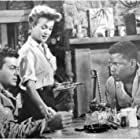 Tony Curtis, Sidney Poitier, and Cara Williams in The Defiant Ones (1958)