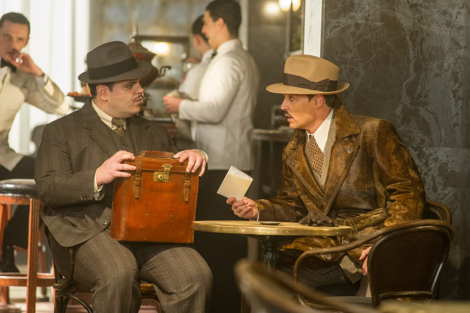 Johnny Depp, Josh Gad, and Sergei Polunin in Murder on the Orient Express (2017)