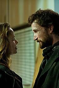 Noah Wyle and Moon Bloodgood in Falling Skies (2011)