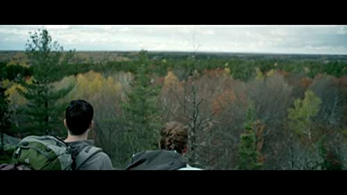 A couple go camping in the woods and find themselves lost in the territory of a predatory black bear.