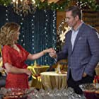 Victor Webster and Lori Loughlin in Homegrown Christmas (2018)