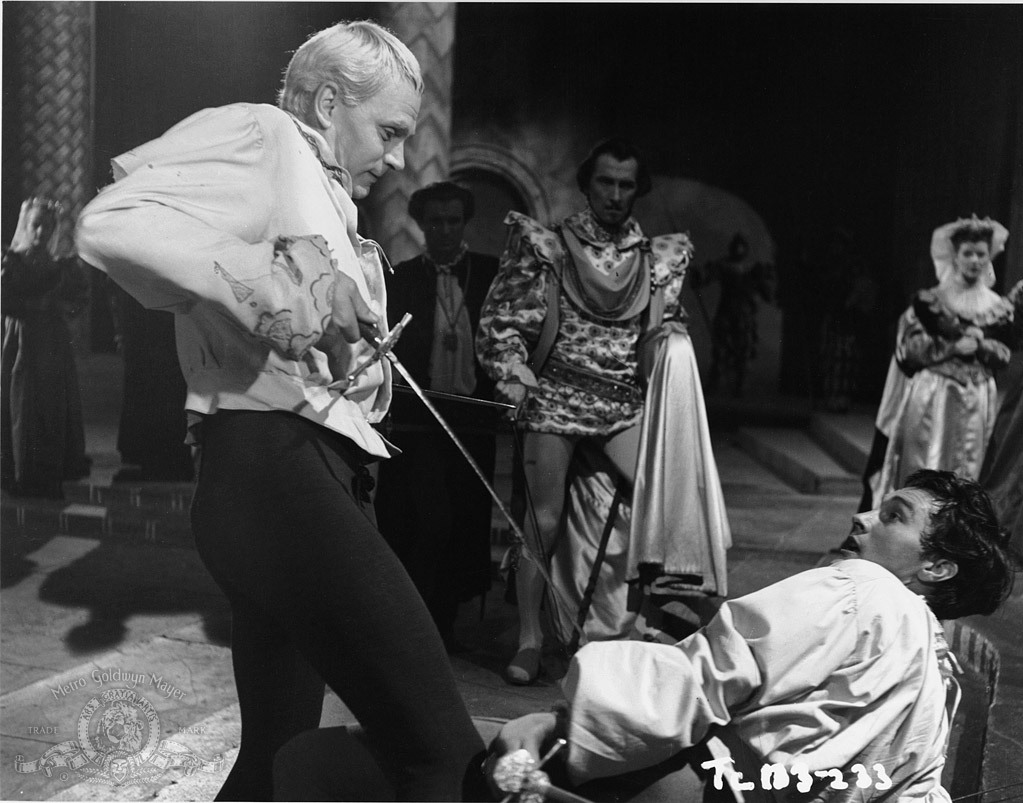 Laurence Olivier, Peter Cushing, and Terence Morgan in Hamlet (1948)