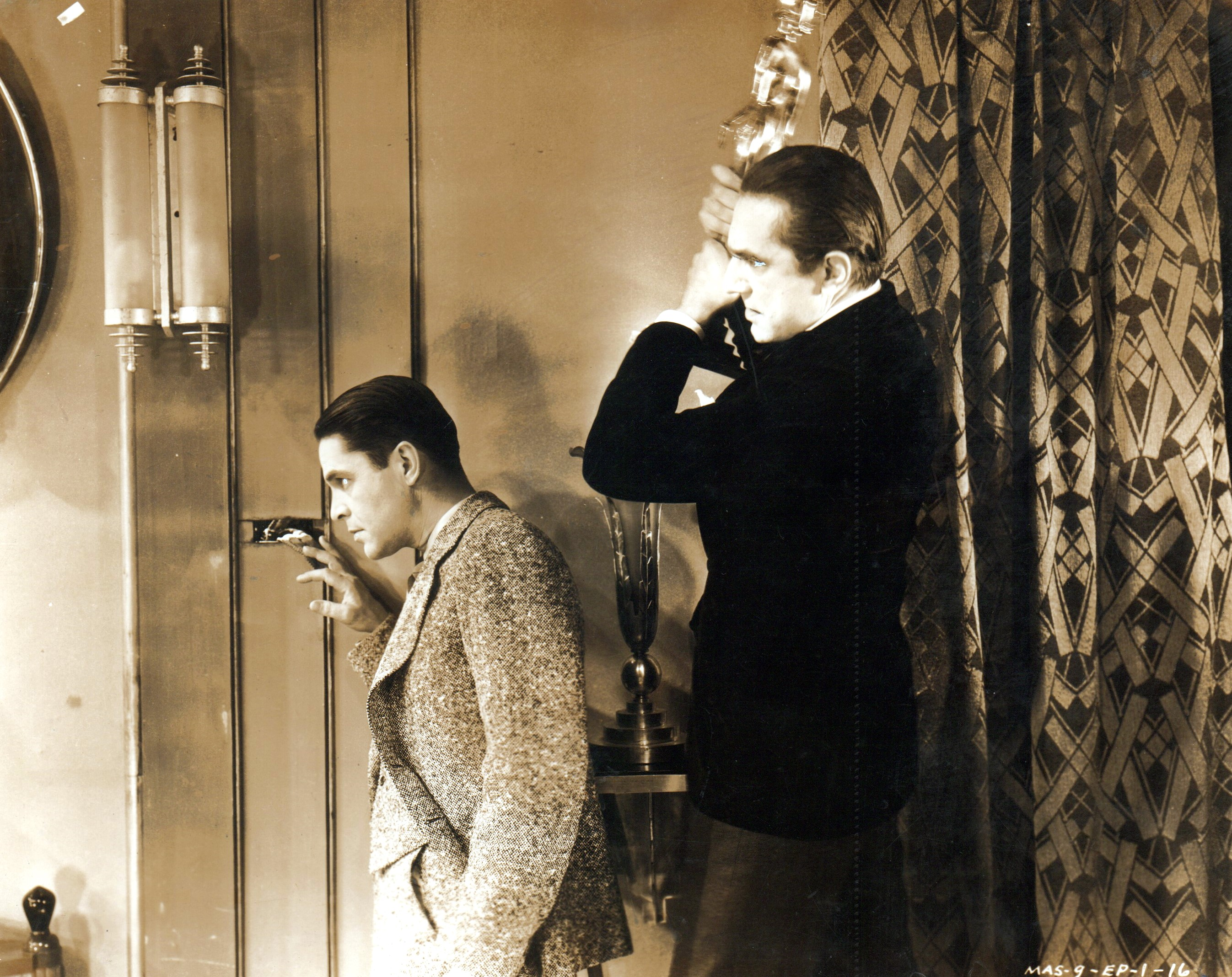 Bela Lugosi and Malcolm McGregor in The Whispering Shadow (1933)