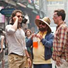 Bradley Cooper, Zach Galifianakis, Ed Helms, and Crystal the Monkey in The Hangover Part II (2011)
