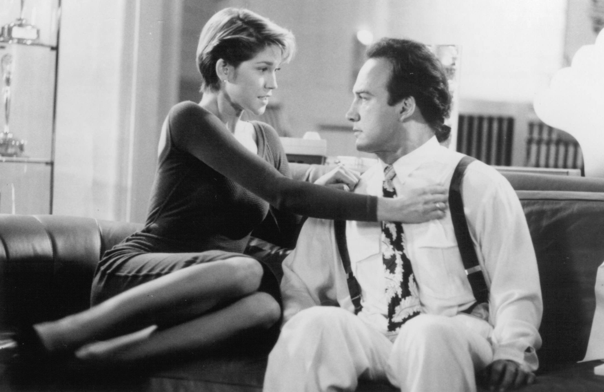 Jim Belushi and Loryn Locklin in Taking Care of Business (1990)