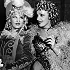 Mae West, Marlene Dietrich (in costume for DESTRY RIDES AGAIN, Universal, 1939), on set of MY LITTLE CHICKADEE, Universal, 1940, **I.V.