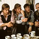 Brad Pitt, Jason Flemyng, Michael Hughes, and Liam McMahon in Snatch (2000)