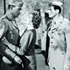 John Wayne, Claudette Colbert, and Don DeFore in Without Reservations (1946)