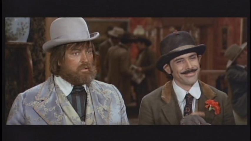 Tomas Milian and Gregg Palmer in La vita, a volte, è molto dura, vero Provvidenza? (1972)
