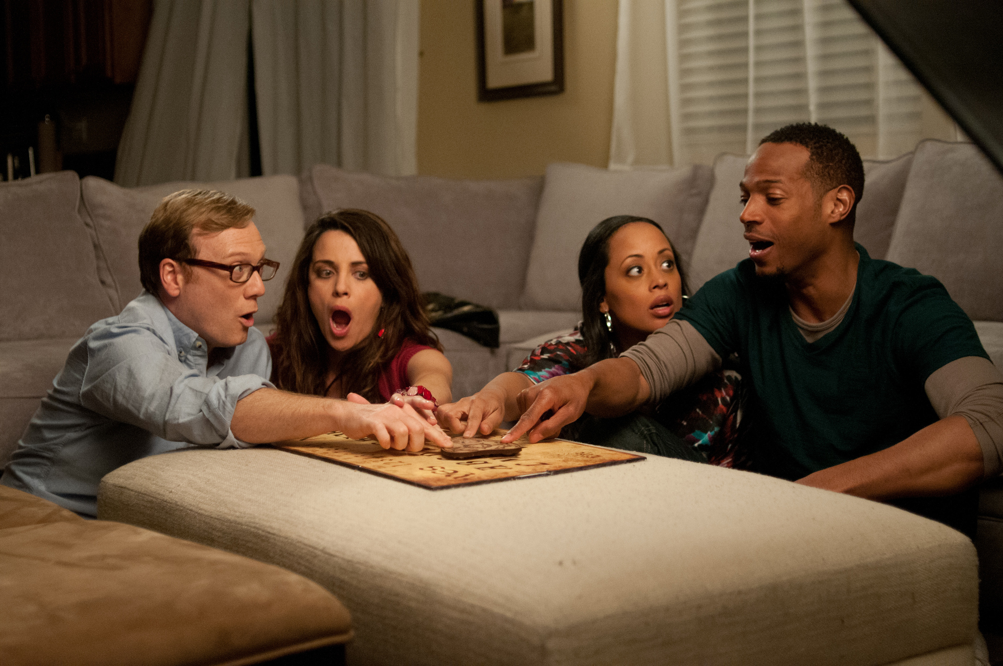 Alanna Ubach, Marlon Wayans, Essence Atkins, and Andrew Daly in A Haunted House (2013)