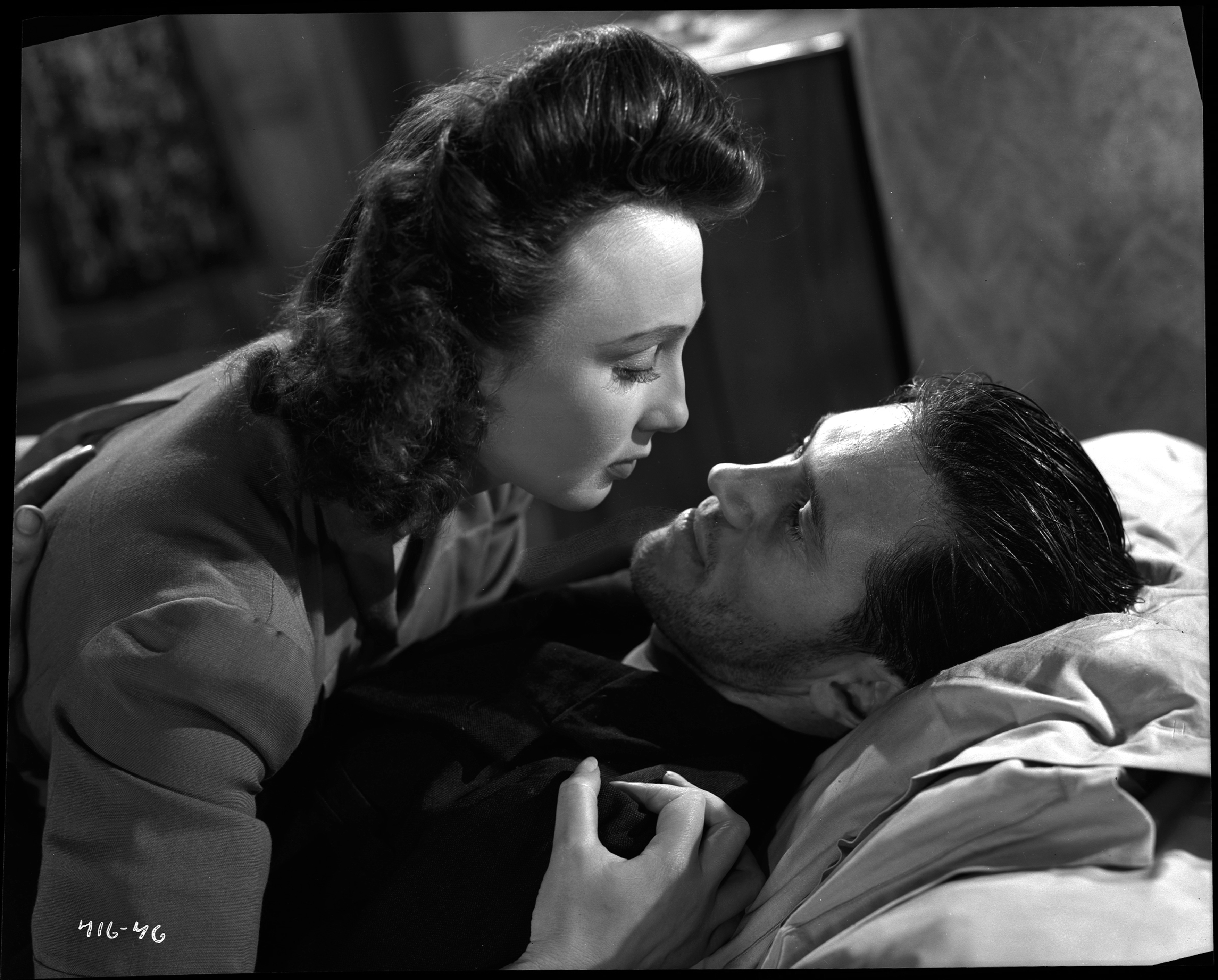 John McCallum and Googie Withers in It Always Rains on Sunday (1947)