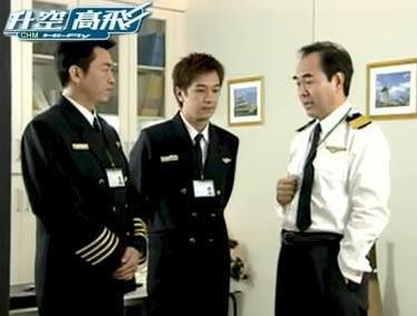 Tuo Zong Hua and Ho-Man Chan in Sheng Kong Gao Fei (2004)