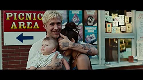 A motorcycle stunt rider turns to robbing banks as a way to provide for his lover and their newborn child, a decision that puts him on a collision course with an ambitious rookie cop navigating a department ruled by a corrupt detective.