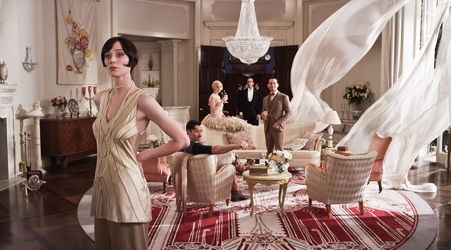 Tobey Maguire, Joel Edgerton, Carey Mulligan, and Elizabeth Debicki in The Great Gatsby (2013)