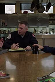 David Eigenberg, Monica Raymund, and Yuriy Sardarov in Chicago Fire (2012)
