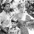 Melanie Griffith, Don Johnson, and Elijah Wood in Paradise (1991)