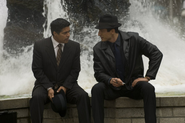 Esai Morales and Sasha Roiz in Caprica (2009)
