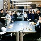 Andy Lau, Eric Tsang, and Anthony Chau-Sang Wong in Mou gaan dou (2002)