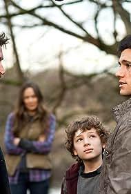 Noah Wyle, Moon Bloodgood, Drew Roy, and Maxim Knight in Falling Skies (2011)