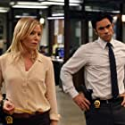 Danny Pino and Kelli Giddish in Law & Order: Special Victims Unit (1999)