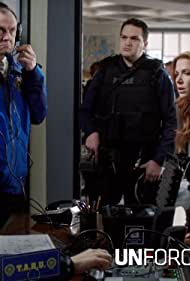 Poppy Montgomery and Dylan Walsh in Unforgettable (2011)