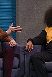 Reggie Watts Wears a Purple and Yellow Quilted Sweatshirt Poster