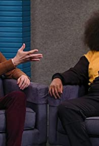 Primary photo for Reggie Watts Wears a Purple and Yellow Quilted Sweatshirt