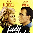 John Wayne and Joan Blondell in Lady for a Night (1942)